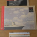 Cunard Line: QM2 ship brochure and fist years sailing brochure.